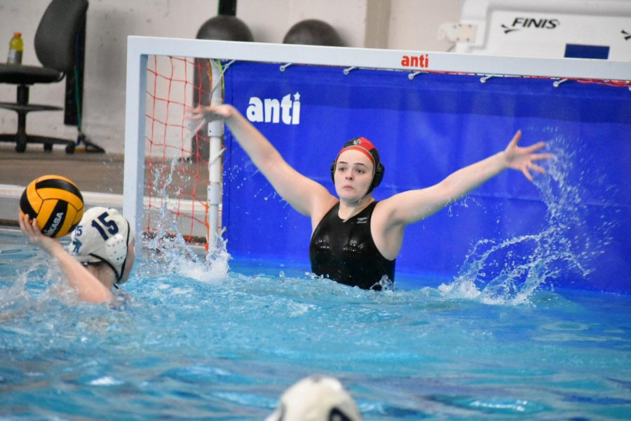 Junior+Peyton+Nufer+jumps+to+block+a+shot+during+an+intense+water+polo+game.+%0APhoto+by+Demi+Ovalle